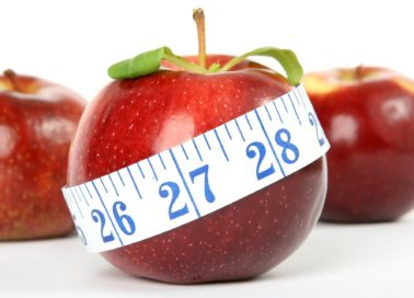 Image or apple with tape measure around it