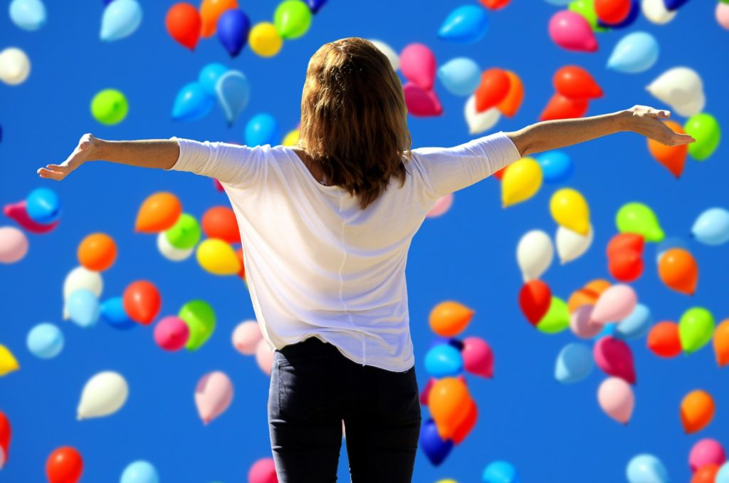 Image of women arms stretched out balloons