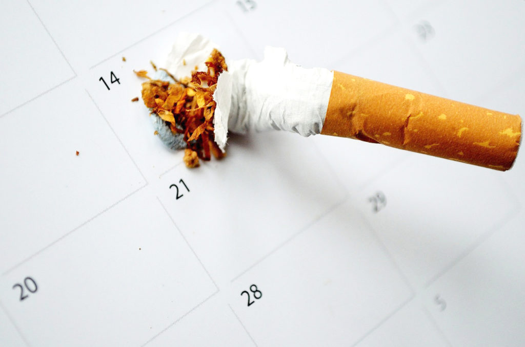 Cigarette smashed on calendar