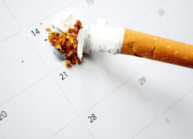 Cigarette smashed on calendar